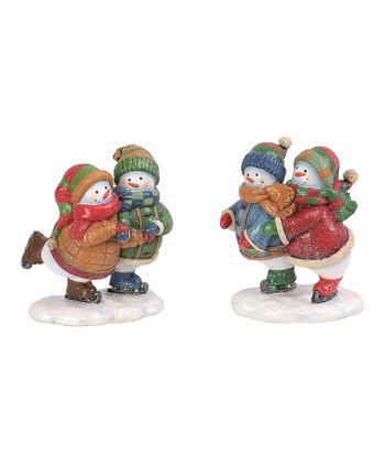 Skating Snow Couple Figurine Set