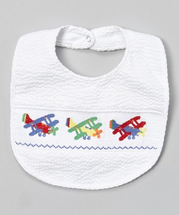 White Airplane Smocked Bib