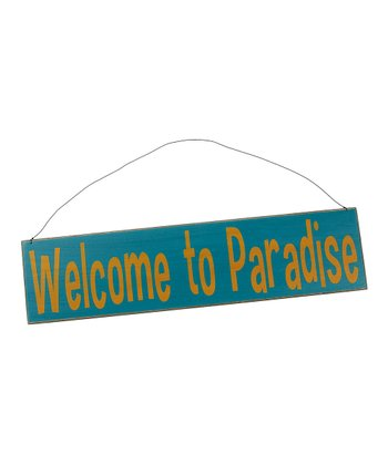 Blue 'Welcome to Paradise' Sign