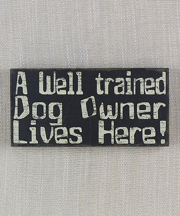White 'Well Trained Dog Owner' Sign