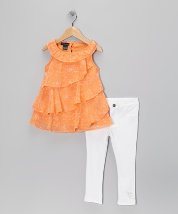 Orange Ruffle Tunic & White Jeggings